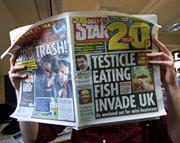 Tabloid newspaper reader
