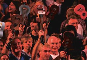 Members of the public performing with the Ukulele Orchestra of Great Britain