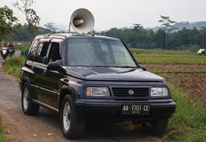 Car with loudspeaker